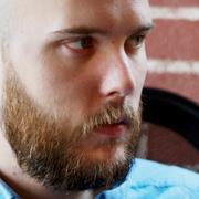 Headshot graphic of Evan Tishuk